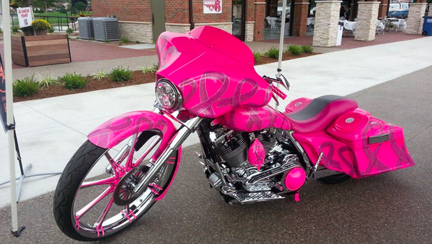 pink motorcycle cancer breast michigan wife died honors screen jody resident stands outside