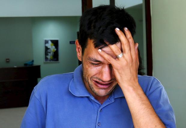 Abdullah Kurdi, father of three-year old Aylan Kurdi, cries as he leaves a morgue in Mugla, Turkey