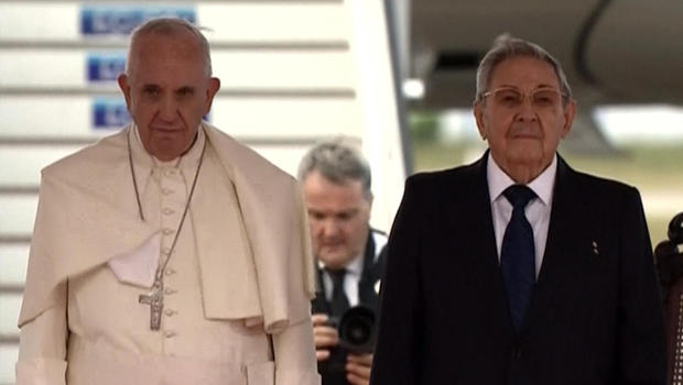 Pope Francis stands with Cuban President Raul Castro after arriving in Havana Sept. 19, 2015.