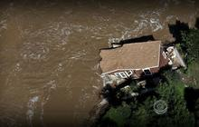 As waters recede in Colo., residents return to assess the damage