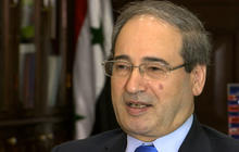 Syria gov't claims it learned of chemical attack on TV