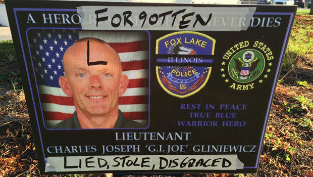 Defaced memorial sign for police Lt. Charles Joseph Gliniewicz was placed outside the police department in Fox Lake, Illinois, on Nov. 4, 2015