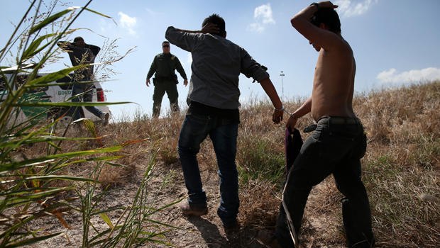 U.S. Border Patrol agents detain undocumented immigrants after they crossed the border from Mexico into the United States Aug. 7, 2015, in McAllen, Texas.