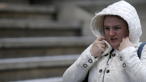 A woman bundles up during the morning commute on Wall Street in lower Manhattan in New York Jan. 19, 2016.
