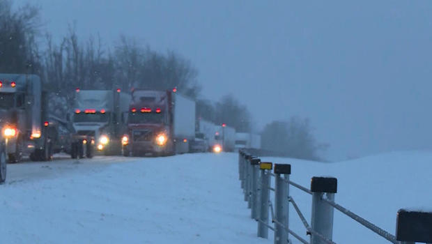 Trucks are stuck on Interstate 75 south of Lexington, Kentucky, Jan. 22, 2016.
