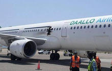 Midair explosion leaves hole in passenger plane