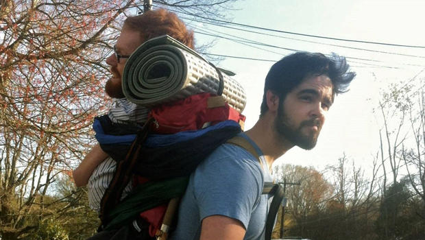 A friend carries Kevan Chandler on his back.