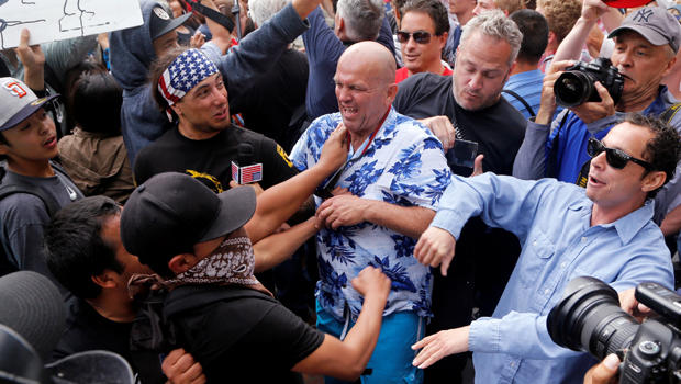 Supporters of Donald Trump and anti-Trump demonstrators clash outside a campaign event for the presumptive Republican presidential nominee in San Diego, California, May 27, 2016.