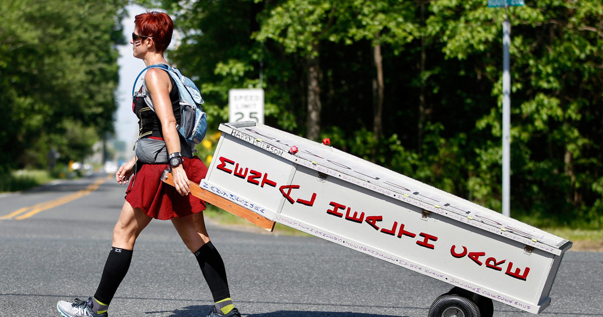 This woman is dragging a casket 80 miles for a very important reason