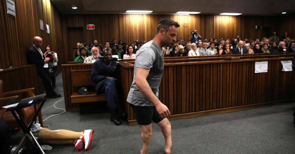 Ahead of sentencing, Pistorius walks without prostheses