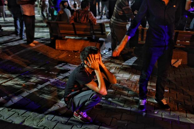 Relative of victim of June 28, 2016 attack in Ataturk Airport waits outside Bakirkoy Sadi Konuk Hospital in early hours of June 29, 2016 in Istanbul, Turkey