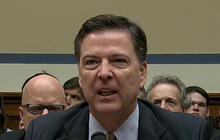 FBI director defends decision on Clinton email case