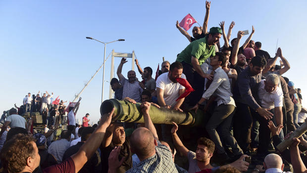 Supporters of Turkish President Recep Tayyip Erdogan celebrate after soldiers involved in the attempted coup surrendered on the Bosphorus Bridge in Istanbul, Turkey, on July 16, 2016.