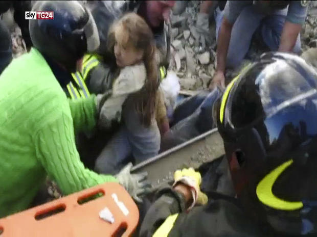 In this image taken from a video, a 10-year-old girl is pulled alive from the rubble following an earthquake in Pescara Del Tronto, Italy