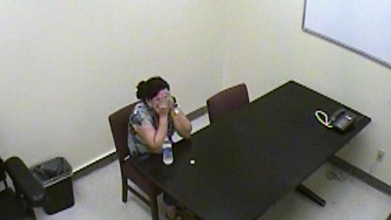 Frances Hall in police interrogation room
