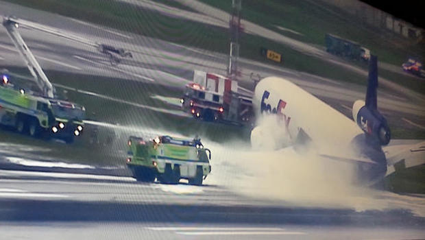FedEx plane catches fire at Florida airport; no injuries