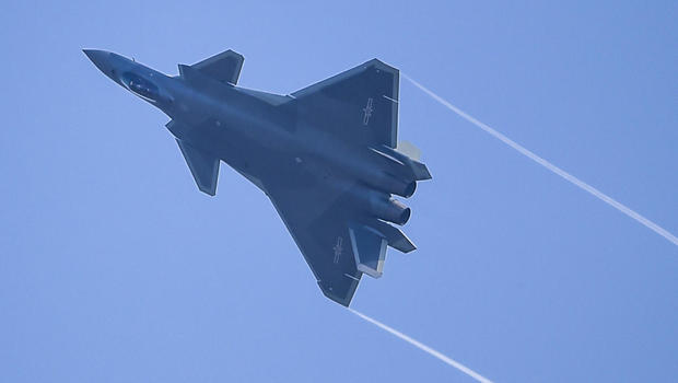 china debuts new j 20 stealth fighter jet cbs news