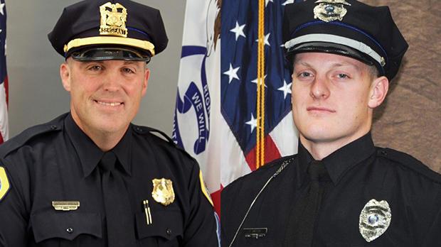 """得梅因警察中士安东尼""""托尼""""贝米尼奥,左,和厄本班达警察贾斯汀马丁在CBS联盟KCCI-TV获得的照片中看到。"""