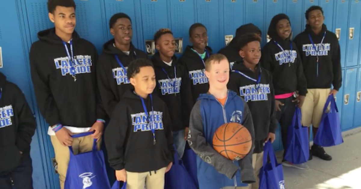 Rival teams work together to help boy with Down syndrome ...