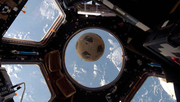 Football from space shuttle Challenger orbiting the Earth again