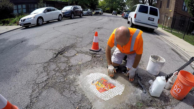 jim-bachor-working-on-pothole-mosaic-b-620.jpg