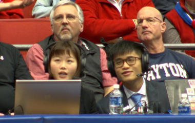 Students provide play-by-play for NCAA basketball fans in China