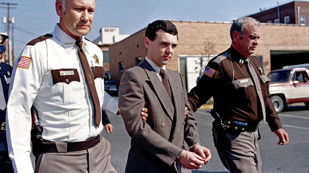 Convicted killer Donald Harvey, center, is led back to jail by Laurel County, Ky., Sheriff Floyd Brummett, left, and an unidentified deputy after pleading guilty to eight murder charges and one voluntary manslaughter charge in London, Ky., on Nov. 2, 198
