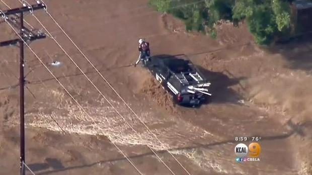 Several drivers were trapped and discovered after complicated rain flooded a Southern California area on Aug. 3, 2017.
