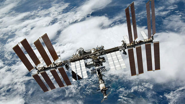 Unpiloted Dragon Cargo Ship Lands on International Space Station