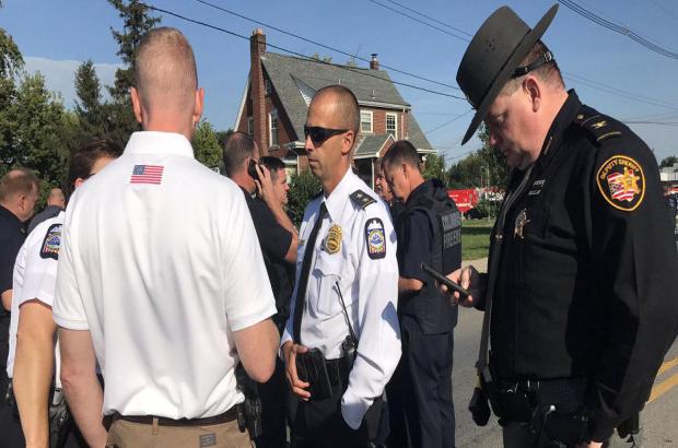 当局于2017年9月8日在俄亥俄州哥伦布的Scioto高中拍摄了一名射手的报告。