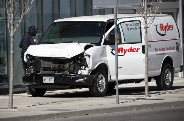 Police inspect a van suspected of being involved in a collision at Yonge Street and Finch Avenue on April 23, 2018, in Toronto, Canada.