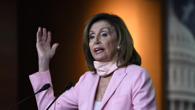 FILE PHOTO: Speaker of the House Pelosi delivers remarks during a weekly news conference on Capitol Hill in Washington