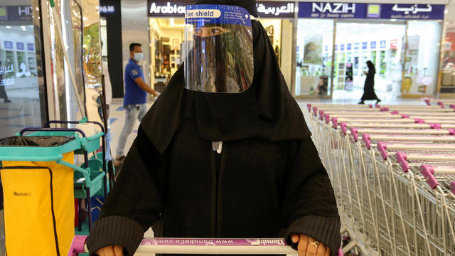 A Saudi woman, wearing a face shield, shops at a supermarket, following the outbreak of the coronavirus disease (COVID-19) in Riyadh