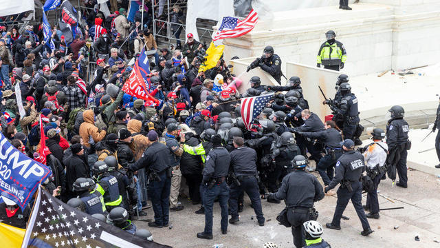 Pro-Trump protesters and police clash on top of the Capitol