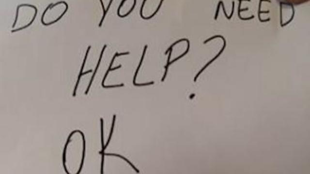 orlando-restaurantg-boy-help-sign.jpg