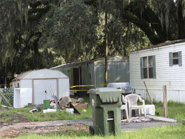 Caller Charged With Mobile Home Deaths