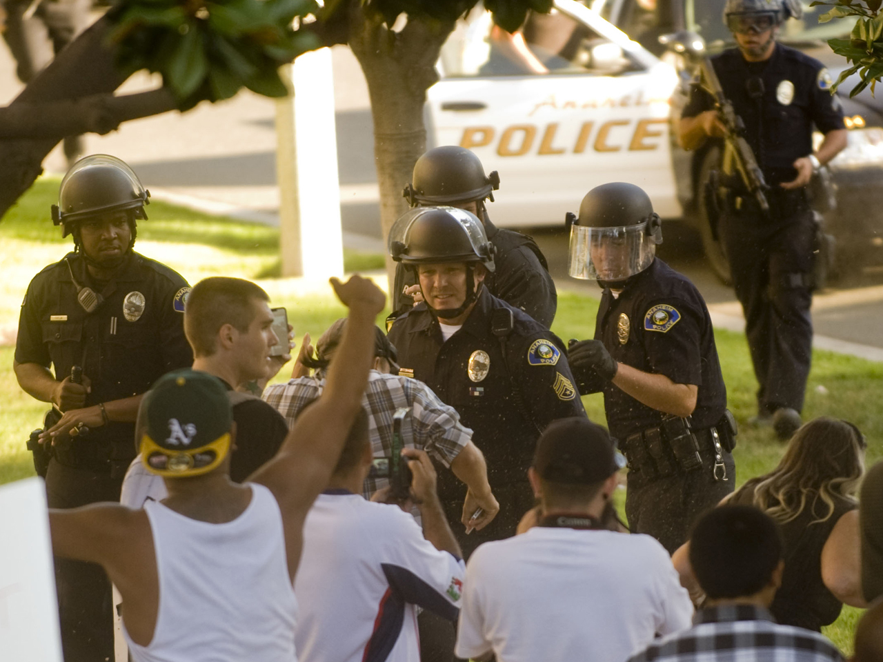 Riot police, protesters clash in Anaheim for 4th night over