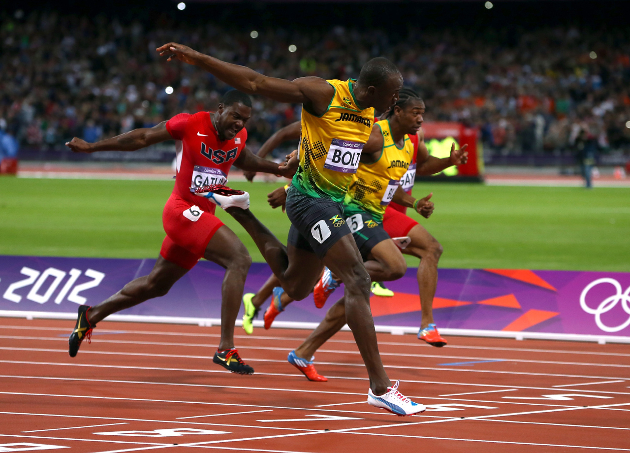 los angeles 1e1ef 8672e Usain Bolt sets Olympic record in men s 100-meter