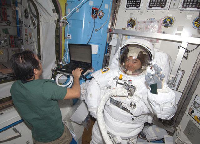 Astronauts take spacewalk outside ISS - CBS News