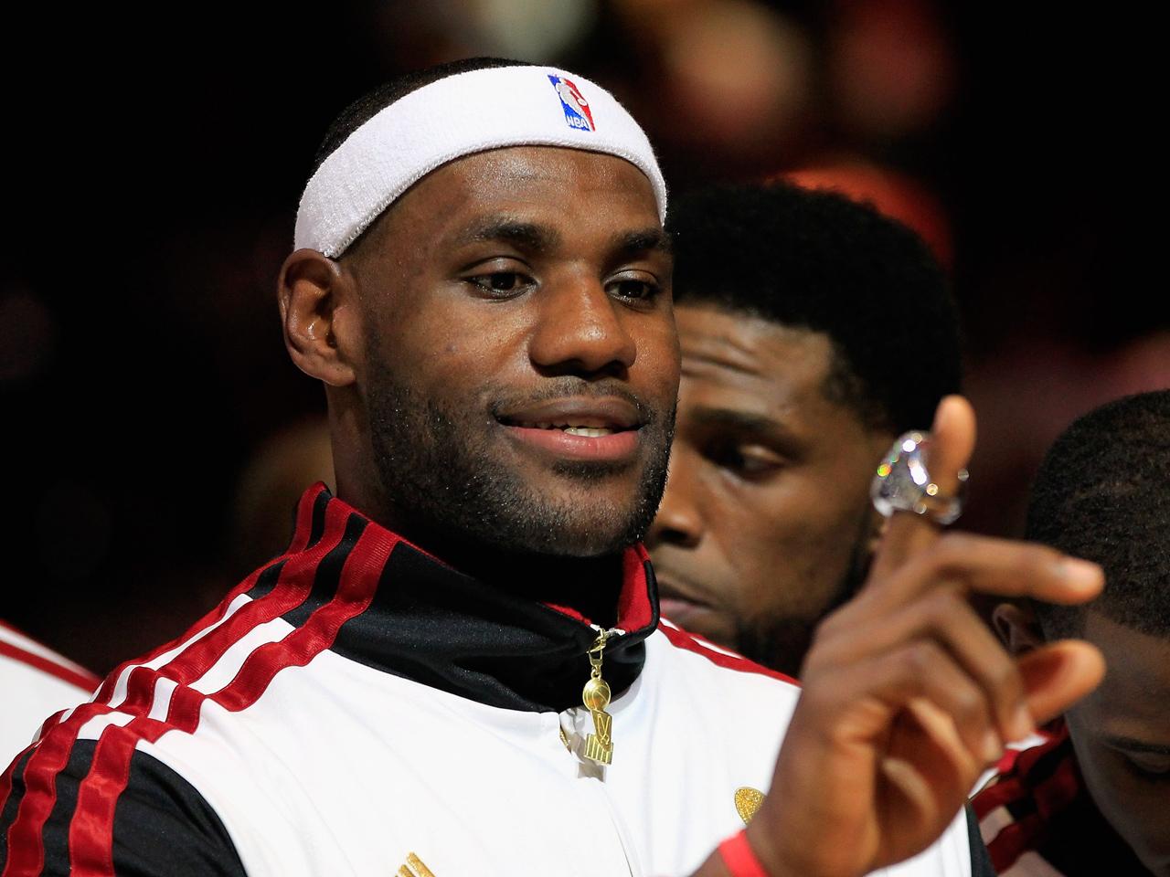 Heat get rings, beat Celtics in NBA season opener - CBS News