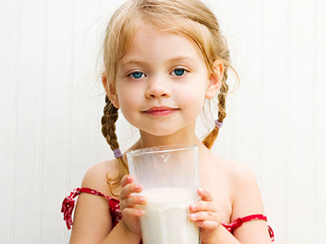 At what age should a child stop drinking whole milk