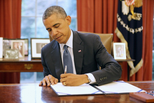 Image result for President Obama signing bill