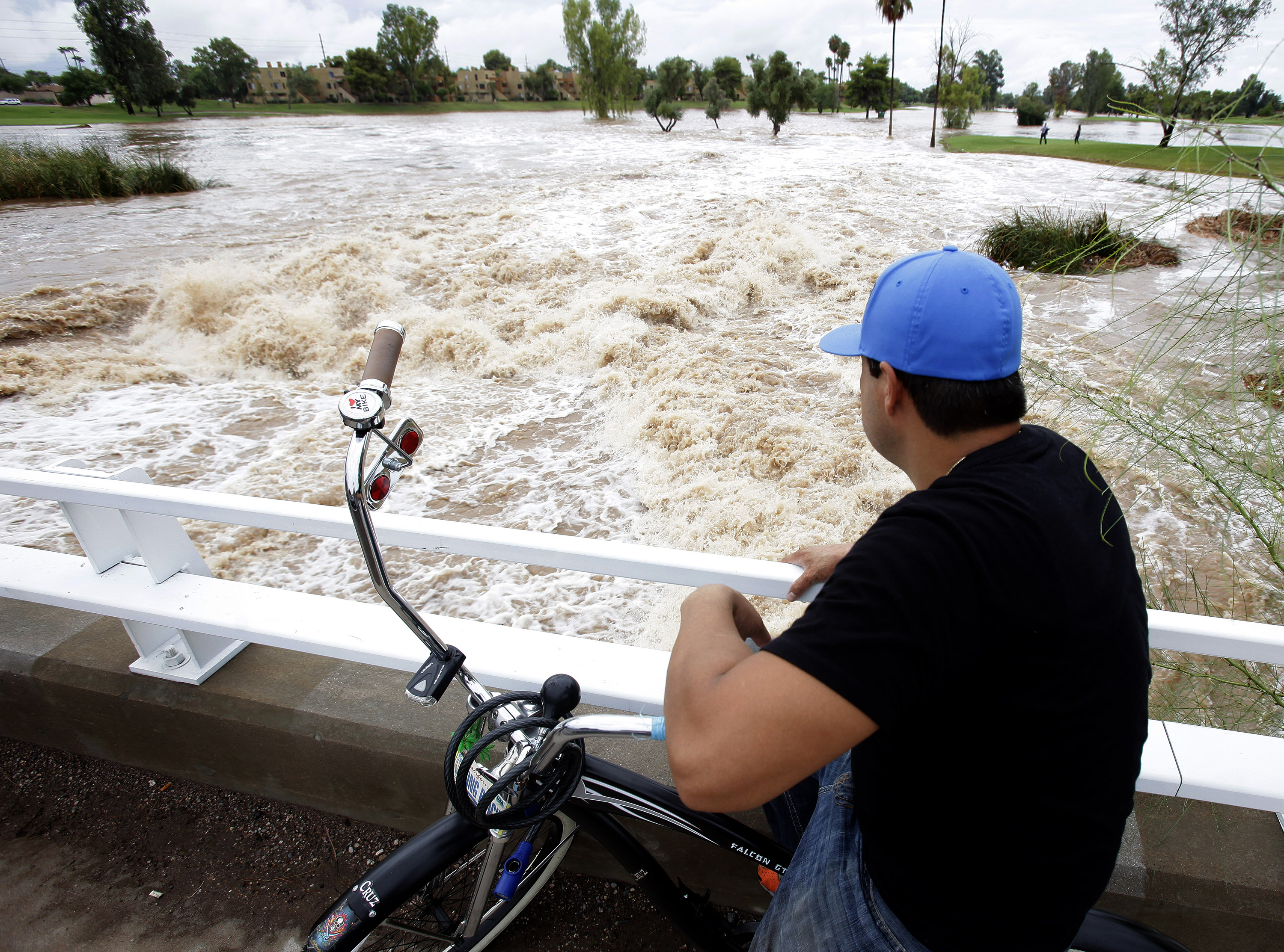 Record rainfall leads to deadly flooding in Arizona - CBS News