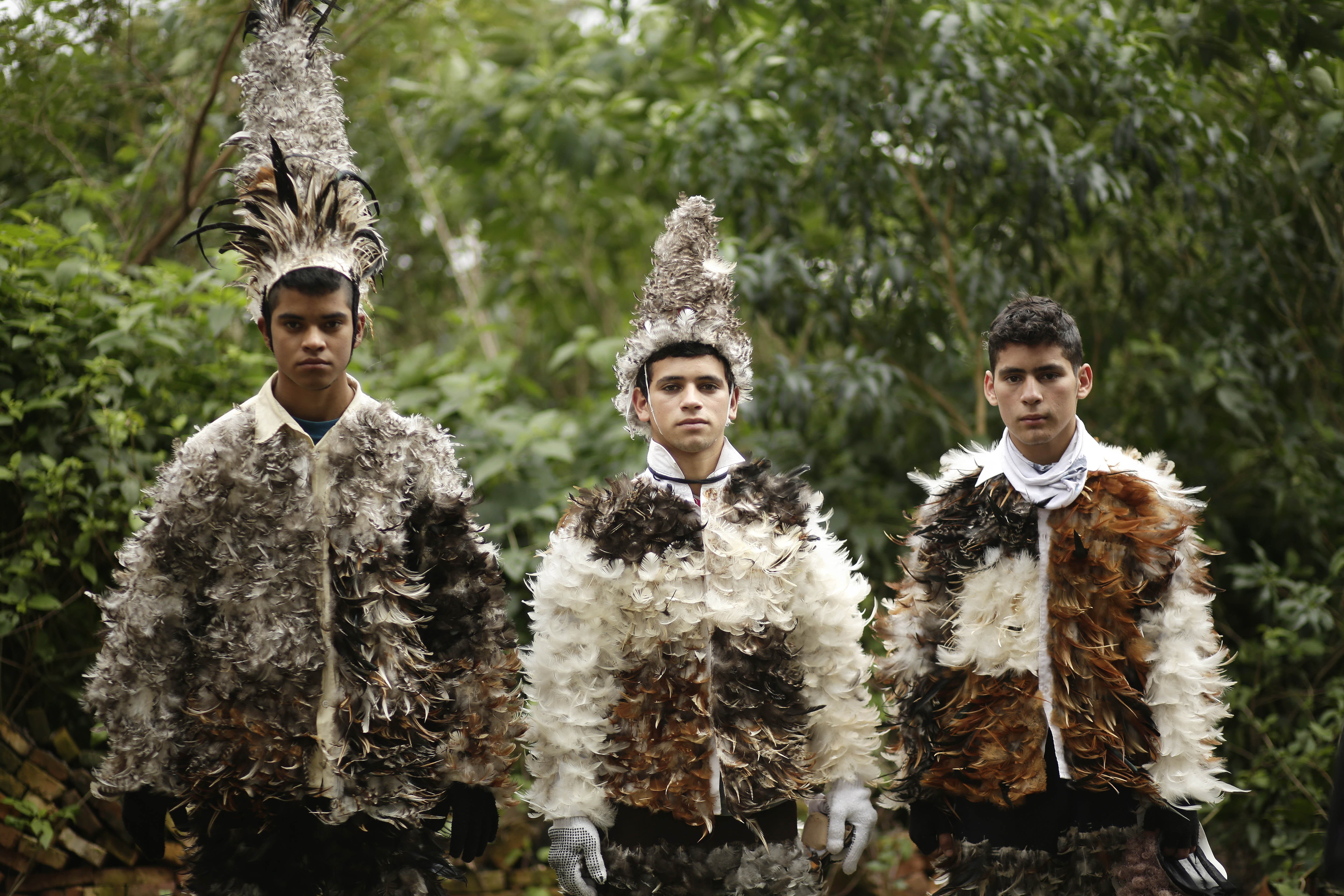 paraguay feather festival dressing in feathers to honor