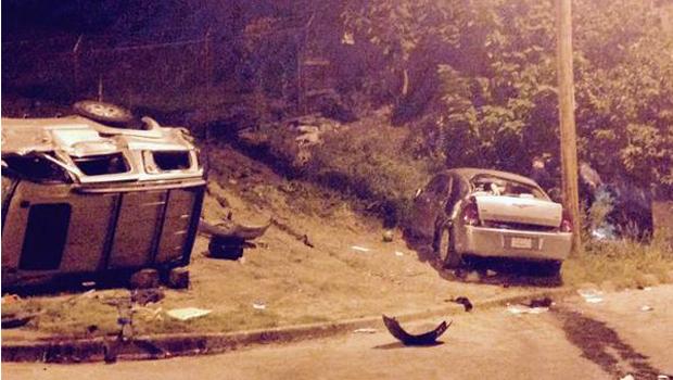 Kansas City, Missouri, rolling gun battle kills woman driving car