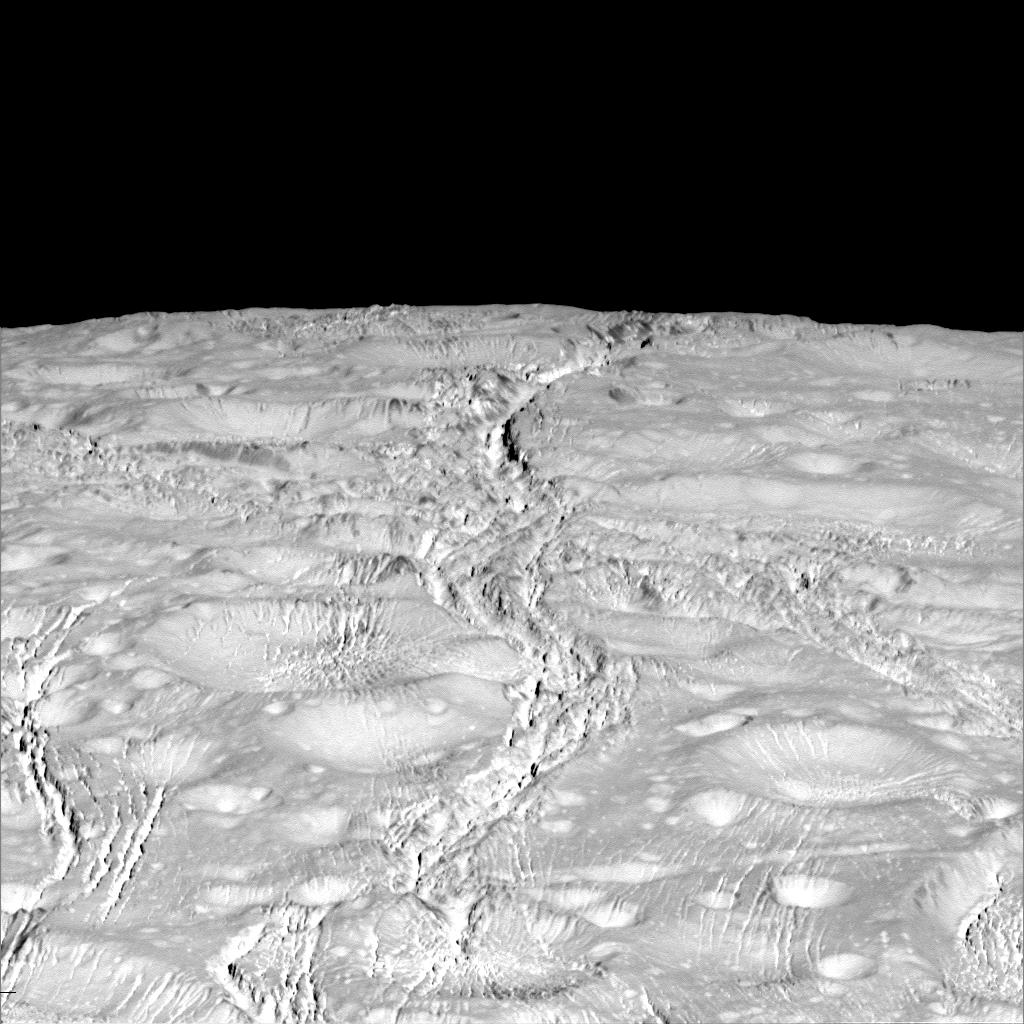 NASA photos zoom in on Saturns cracked cratered moon