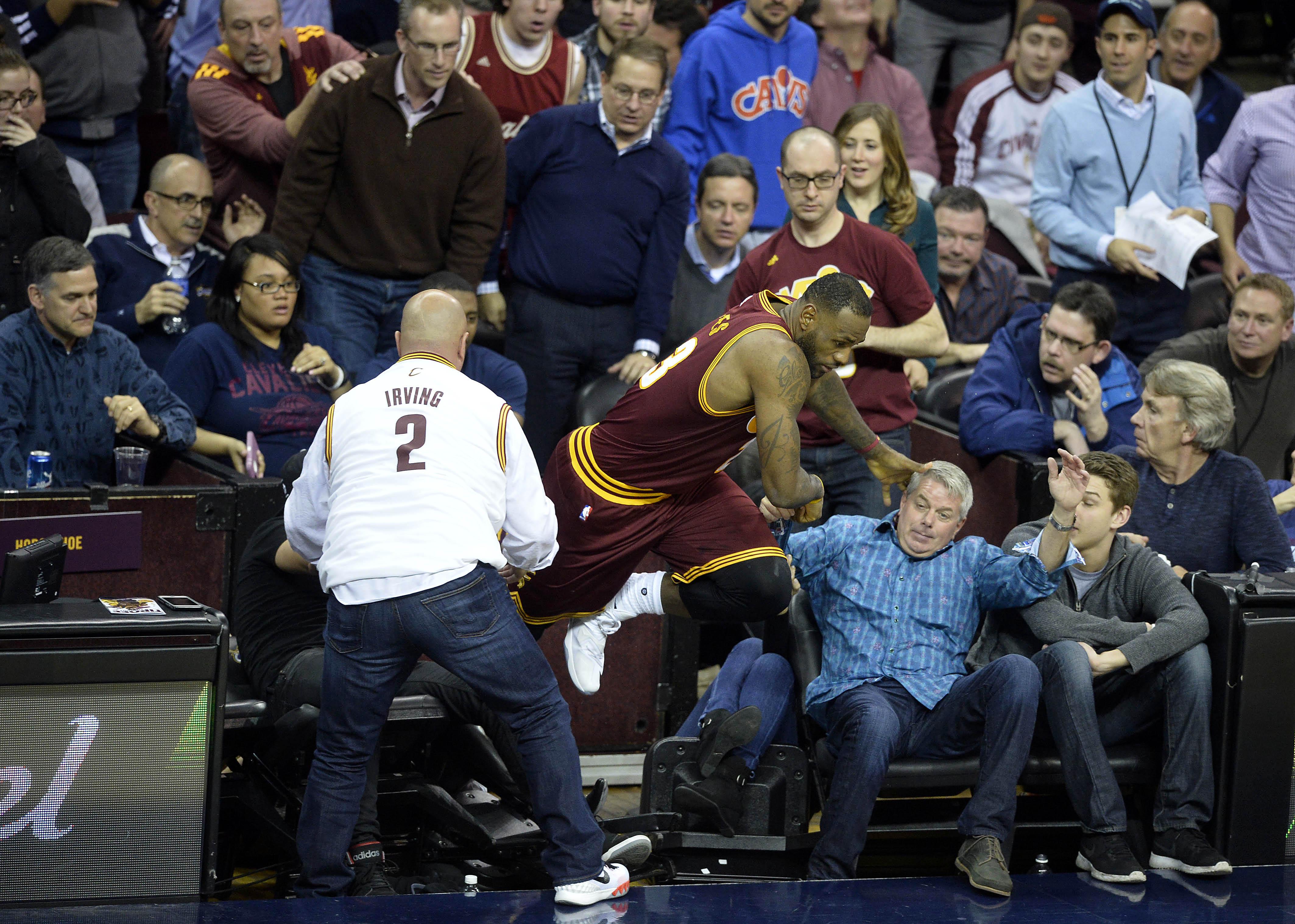 abfe31ffbd4a LeBron James plows into crowd