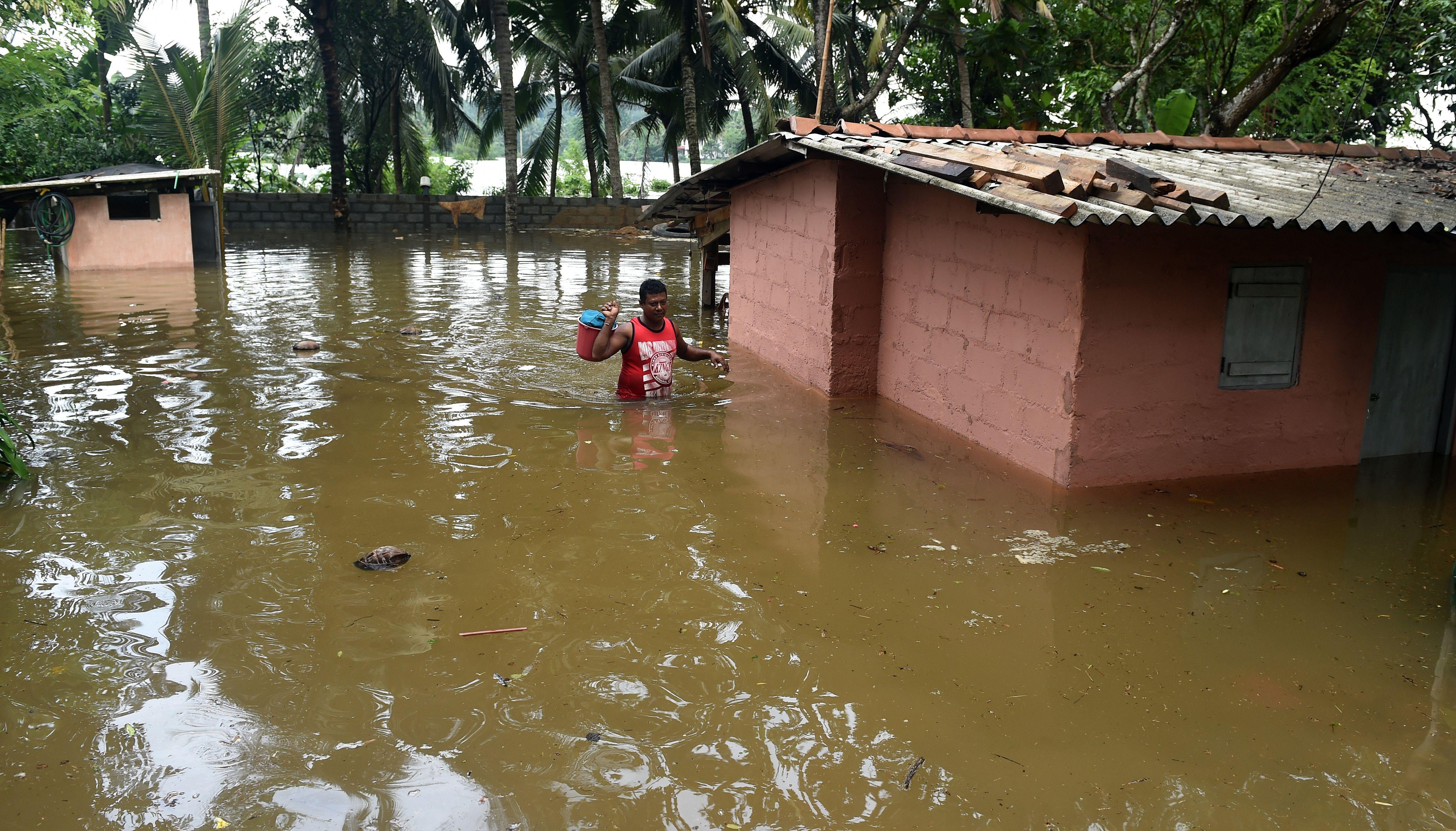 Sri lanka floods unleash landslides and hundreds of - Sri lankan passport office in colombo ...