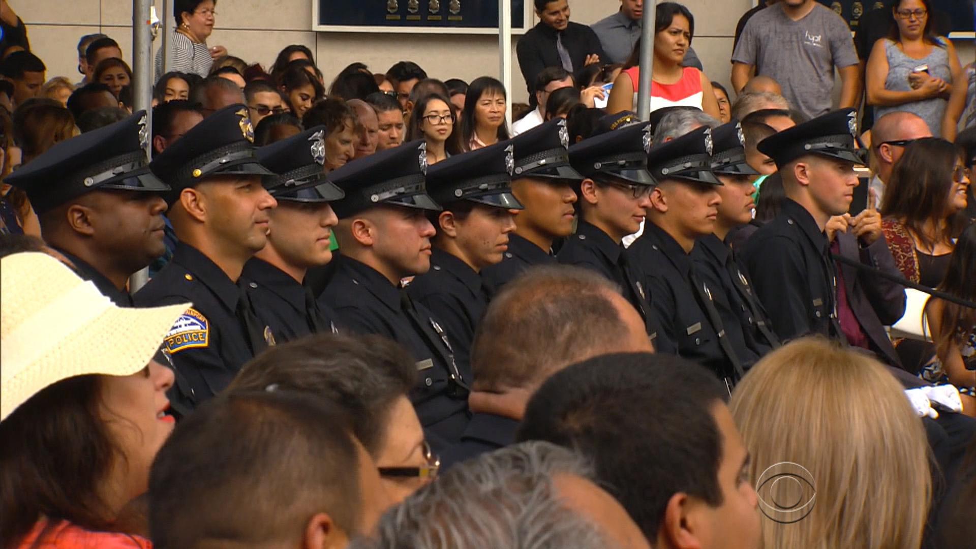 Heavy hearts for Dallas at LAPD graduation ceremony - CBS News