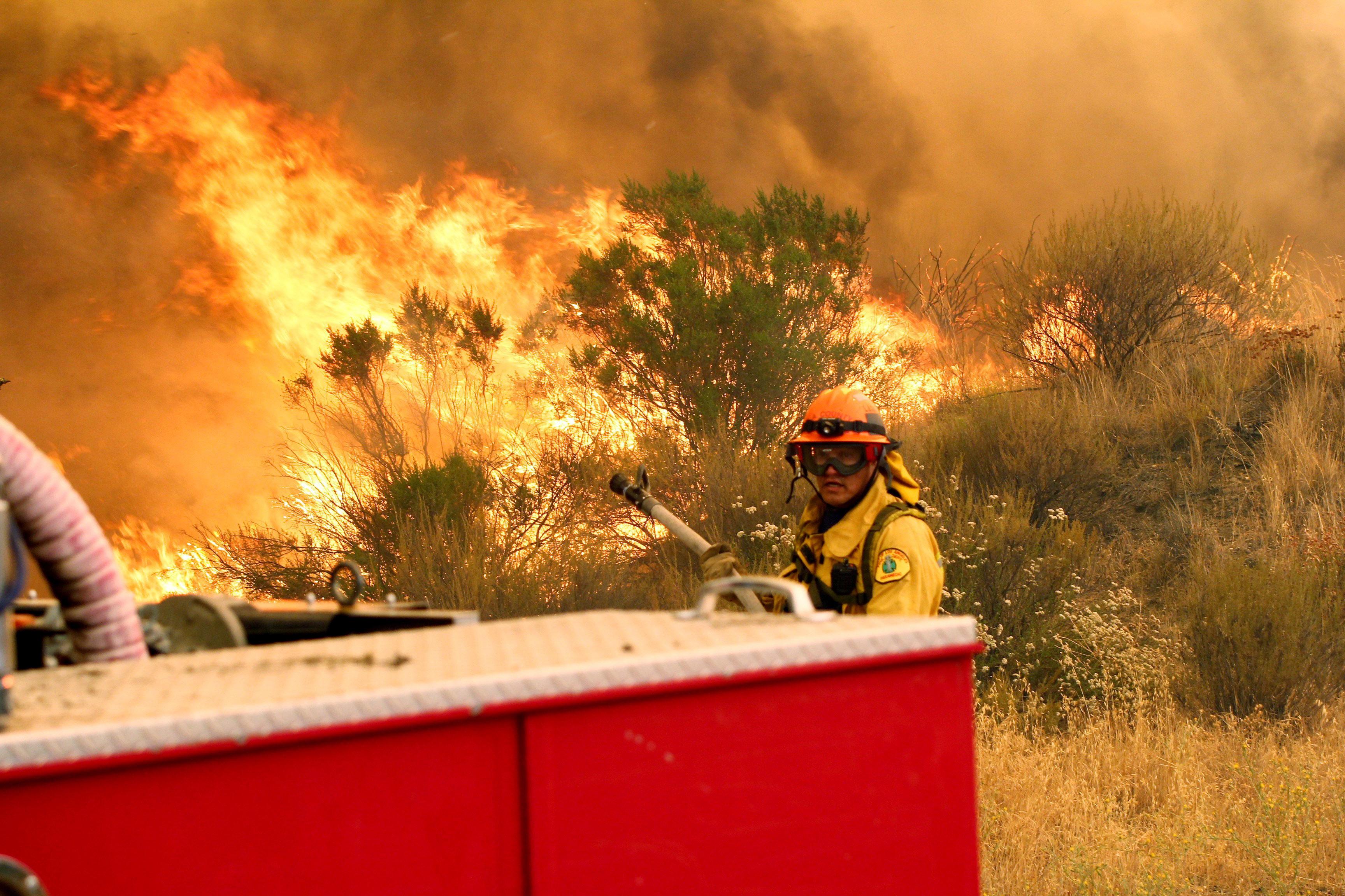 Raging Calif  wildfire charging through terrain